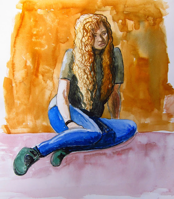 A teenage girl sitting on the floor looking away.