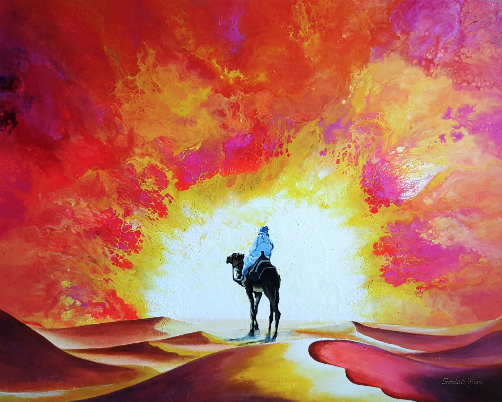 Someone on a camel riding into a colorful sunset.
