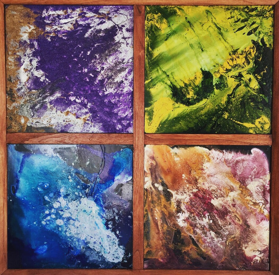 Four abstact paintings, each a different color, in a square.