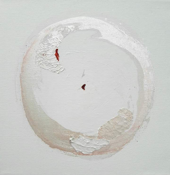 An abstract painting: a white circle with a couple of tiny red dots inside.